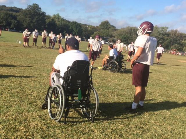 An Austin High School football coach takes part in the 'Wheelchair Challenge'