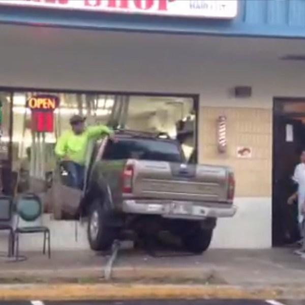 truck into barber shop_77460