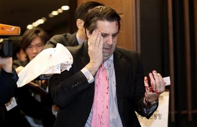 U.S. Ambassador to South Korea Mark Lippert leaves a lecture hall for a hospital in Seoul, South Korea, Thursday, March 5, 2015 after being attacked by a man. Lippert was attacked by a man wielding a razor and screaming that the rival Koreas...