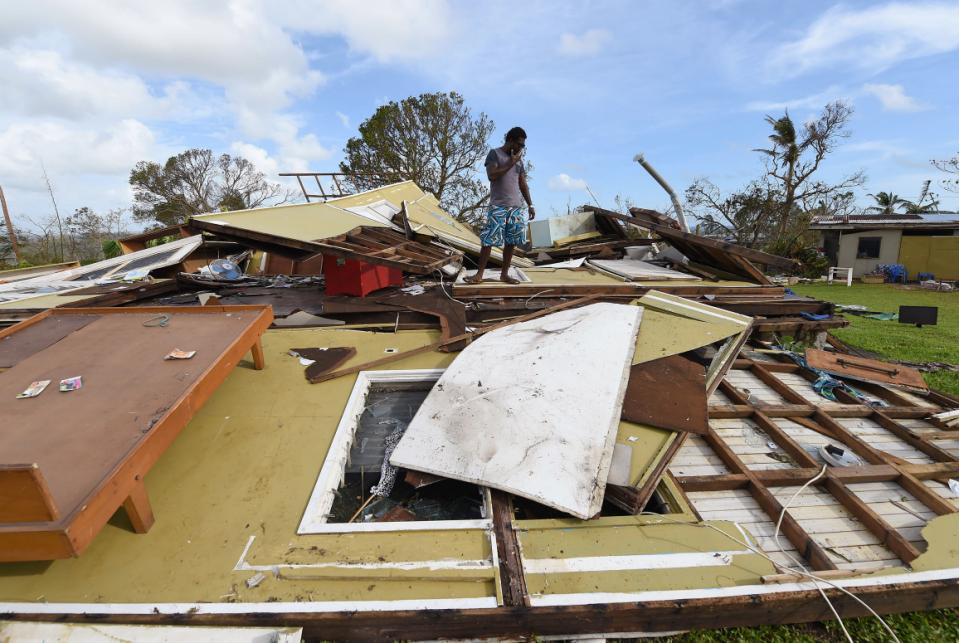 Adrian Banga surveys his destroyed house in Port Vila, Vanuatu in the aftermath of Cyclone Pam Monday, March 16, 2015. Vanuatu's President Baldwin Lonsdale said Monday that the cyclone that hammered the tiny South Pacific archipelago over the...