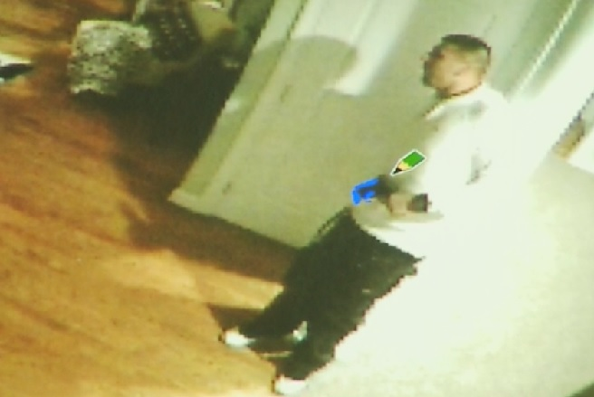 Prosecutors say this surveillance video shows Aaron Hernandez holding a .45-caliber handgun, the day Odin Lloyd was murdered.