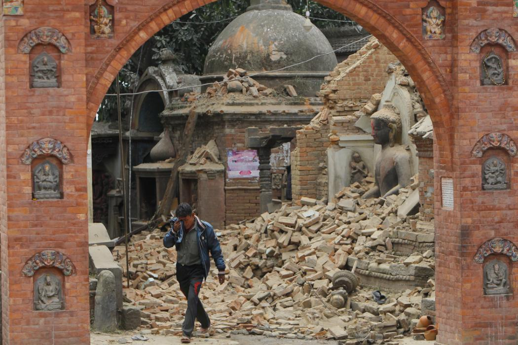 A Nepalese man cries as he walks through the earthquake debris in Bhaktapur, near Kathmandu, Nepal, Sunday, April 26, 2015. A strong magnitude 7.8 earthquake shook Nepal's capital and the densely populated Kathmandu Valley before noon Saturday,...