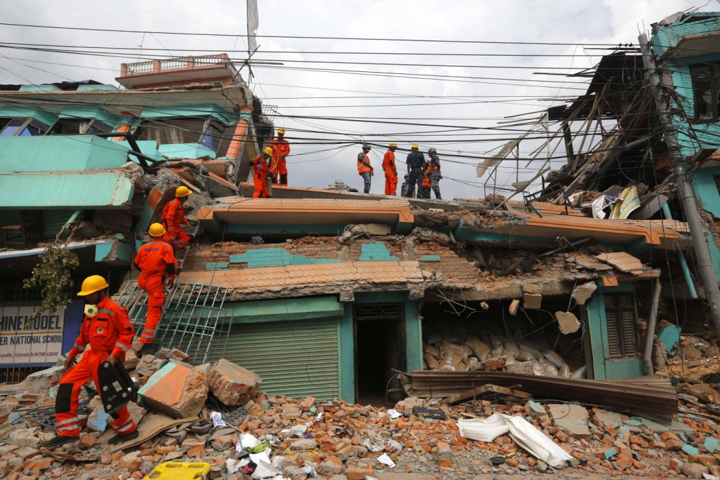 India's National Disaster Response Force personnel look for survivors in a building, in Kathmandu, Nepal, Sunday, April 26, 2015. Sleeping in the streets and shell-shocked, Nepalese cremated the dead and dug through rubble for the missing Sunday,...
