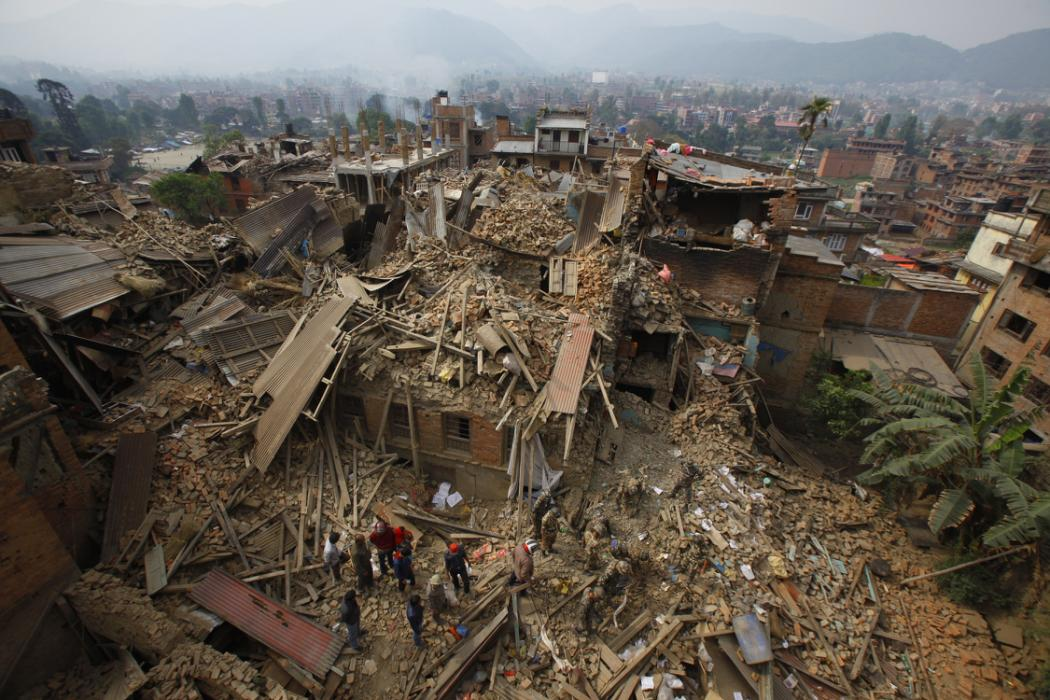 Rescue workers remove debris as they search for victims of earthquake in Bhaktapur near Kathmandu, Nepal, Sunday, April 26, 2015. A strong magnitude earthquake shook Nepal's capital and the densely populated Kathmandu Valley before noon Saturday,...