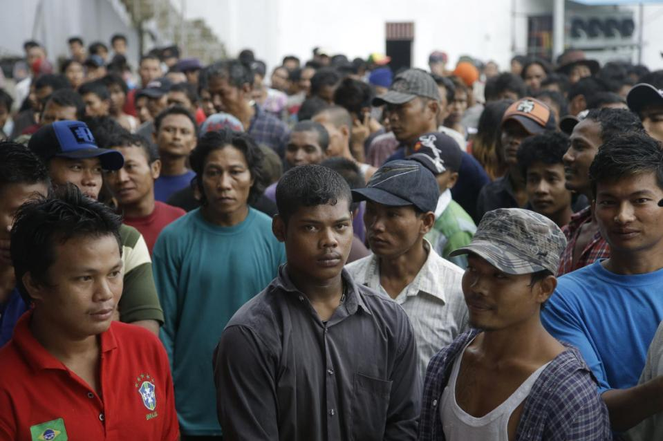 Burmese fishermen wait for their departure to leave the compound of Pusaka Benjina Resources fishing company in Benjina, Aru Islands, Indonesia, Friday, April 3, 2015. Hundreds of foreign fishermen on Friday rushed at the chance to be rescued from...