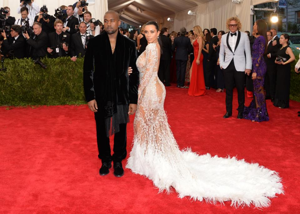 "Kanye West and Kim Kardashian arrives at The Metropolitan Museum of Art's Costume Institute benefit gala celebrating ""China: Through the Looking Glass"" on Monday, May 4, 2015, in New York. (Photo by Evan Agostini/Invision/AP)"