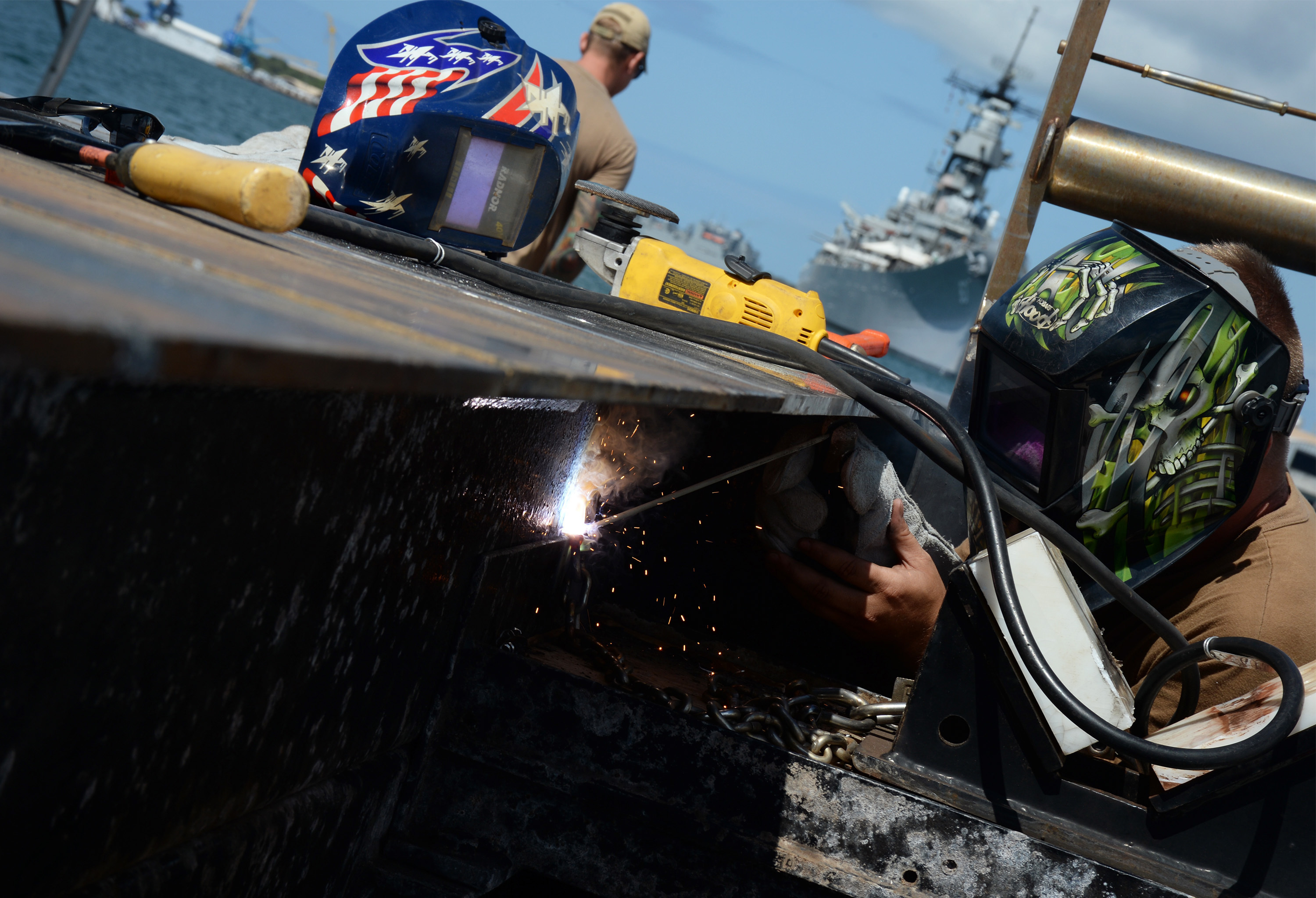 A sailor works to repair the floating dock at the USS Arizona Memorial (Photo: Navy Region Hawaii)