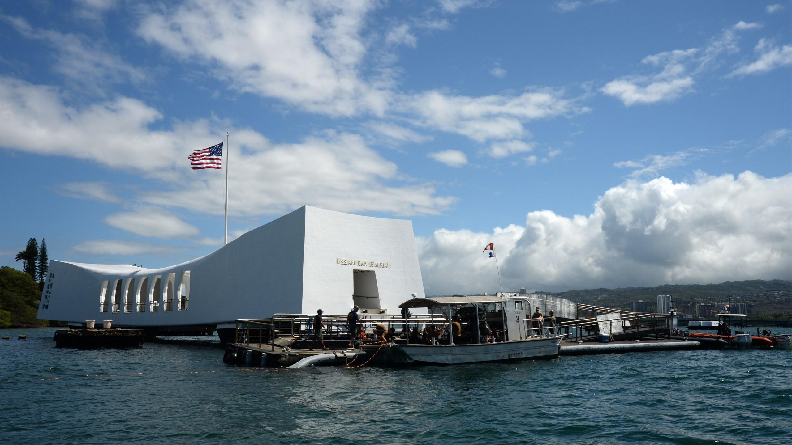 Sailors work to repair the floating dock next to the USS Arizona Memorial_98123