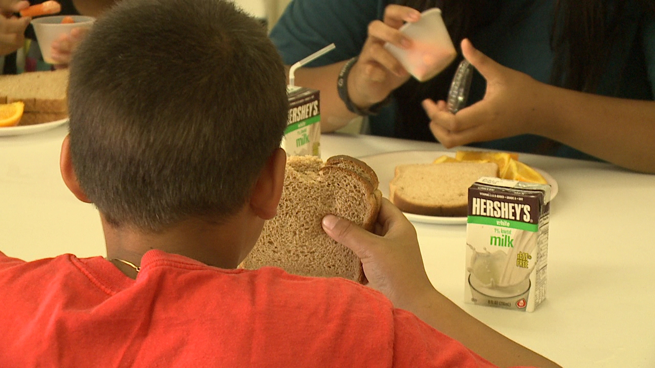 3-24 YMCA feeds children_149390