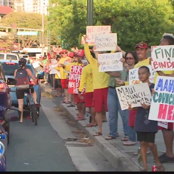 Union members, supporters wave signs in favor of funding lifeguards contract