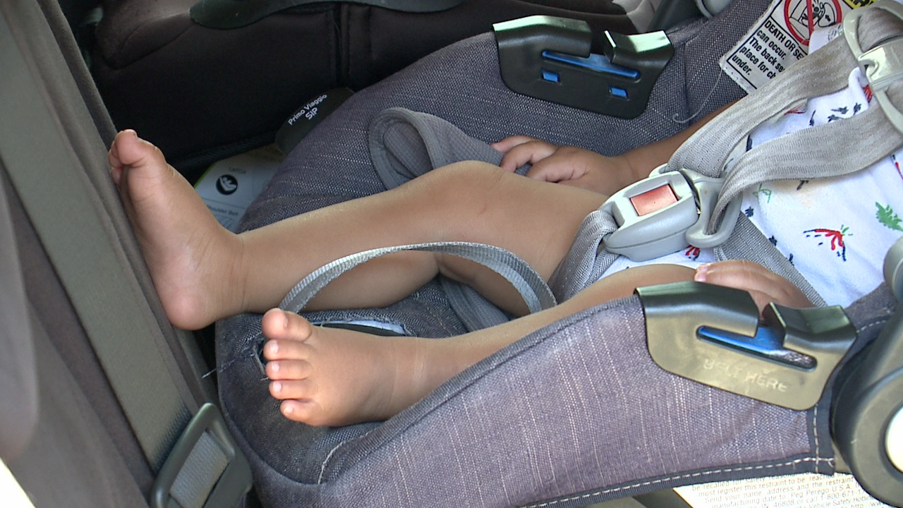 child in car seat_220995