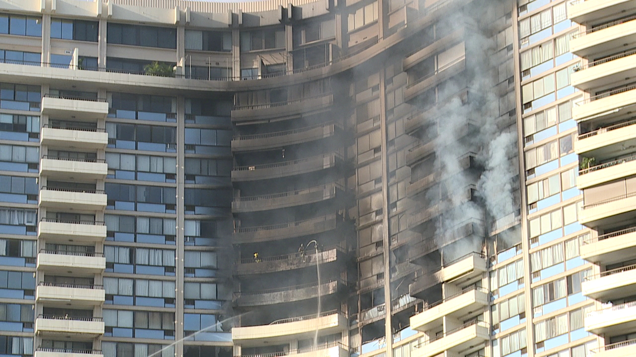firefighters in marco polo building (1)_217738