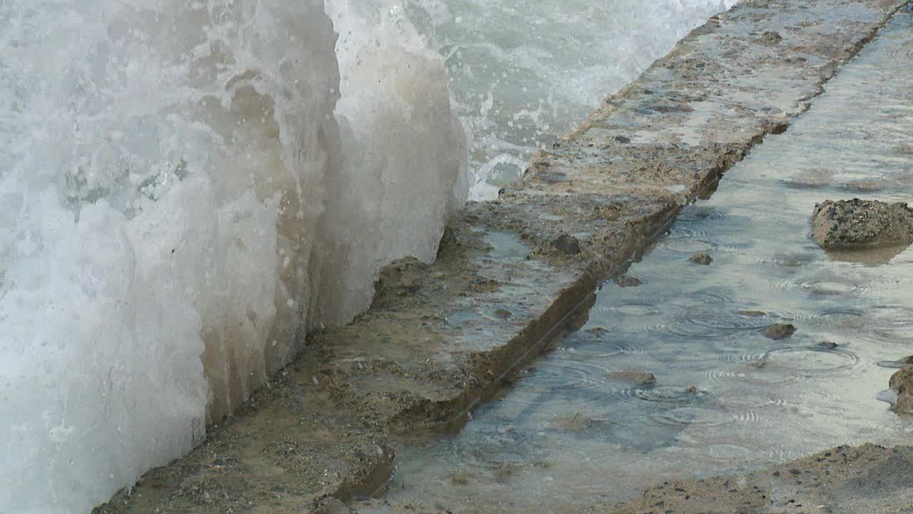 sea level rise ocean crashing waves on shore