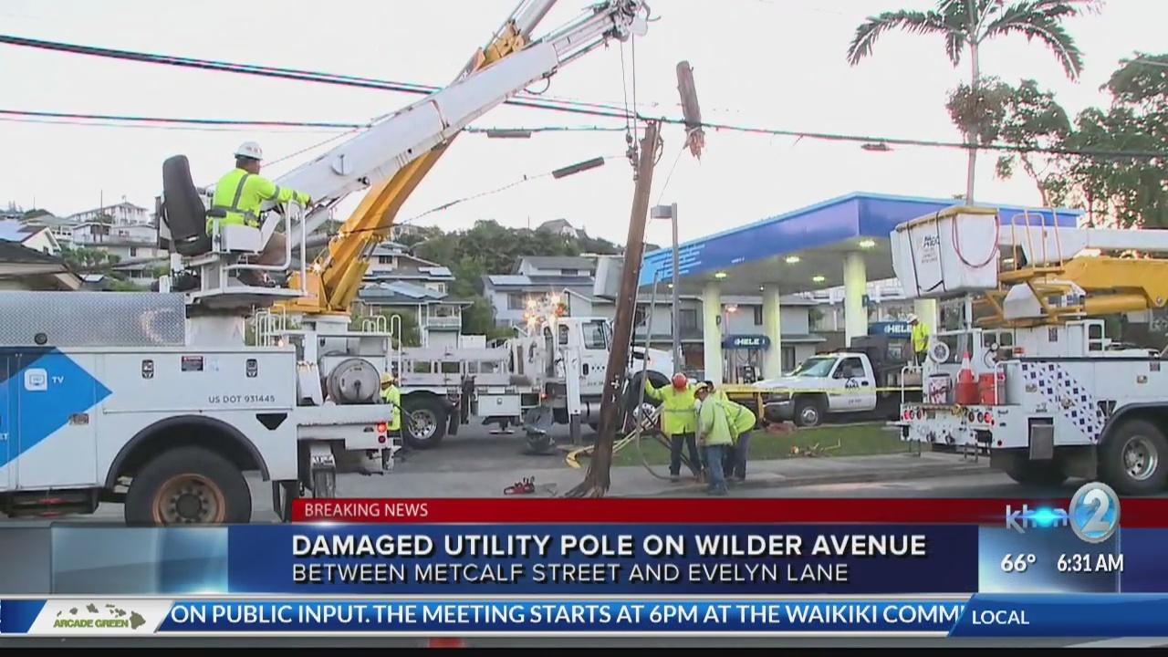 Car collision causes broken power pole.