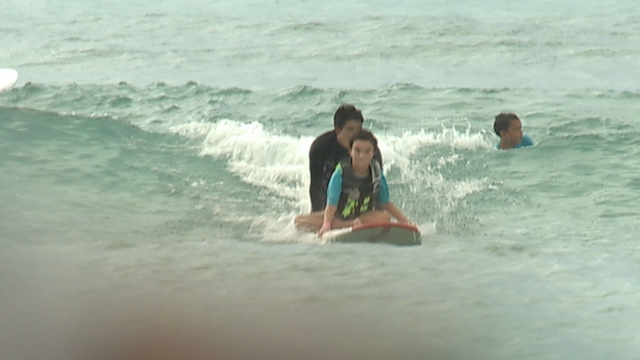 Volunteers give surf lessons to sick children at the 16th annual Surf4HUGS event