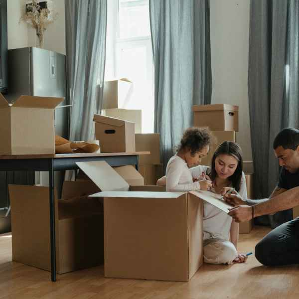 family unpacking after moving