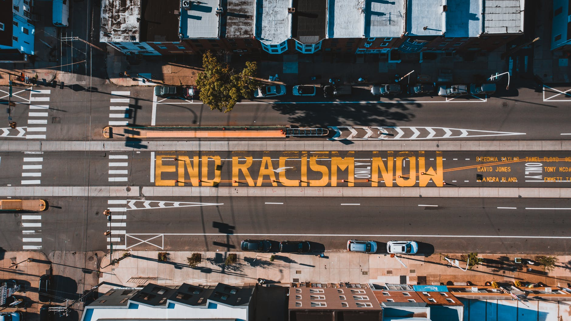 roadway with end racism now title in town