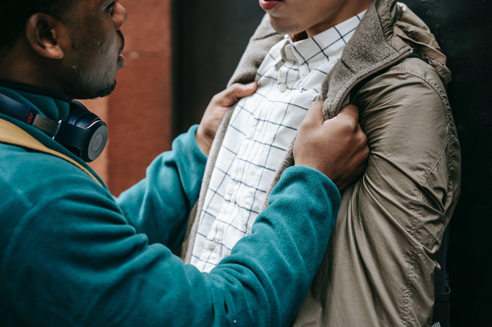 anonymous multiethnic men having conflict on street